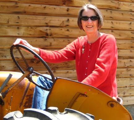 Ridingayellowtractorinaredsweater